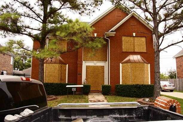 Windows boarded up with plywood for Hurricane Ike