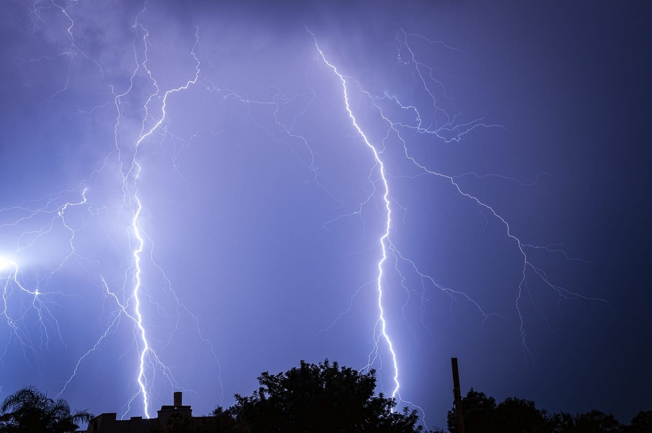lightning-bolts-against-dark-blue-sky