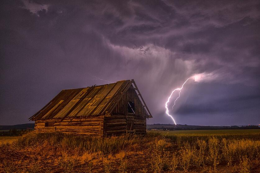 lightning strike on barn in Iowa farm