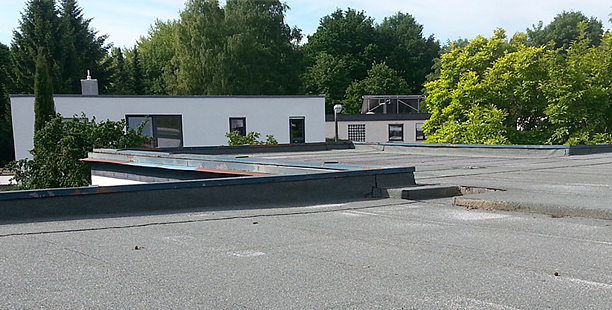 flat-commercial-roof-leak.png
