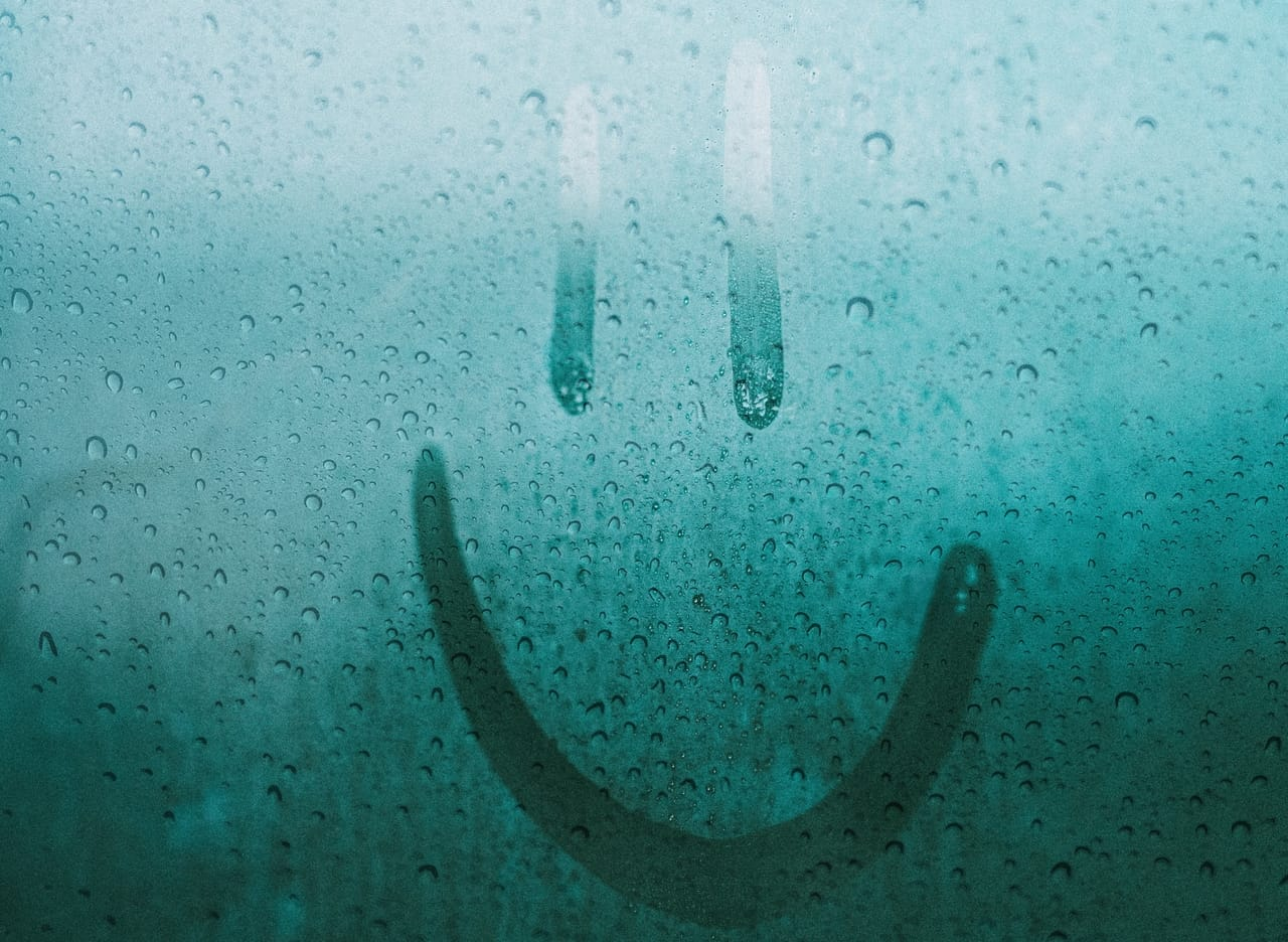smiley-face-in-condensation-on-window