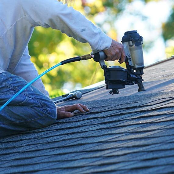man-repairing-roof