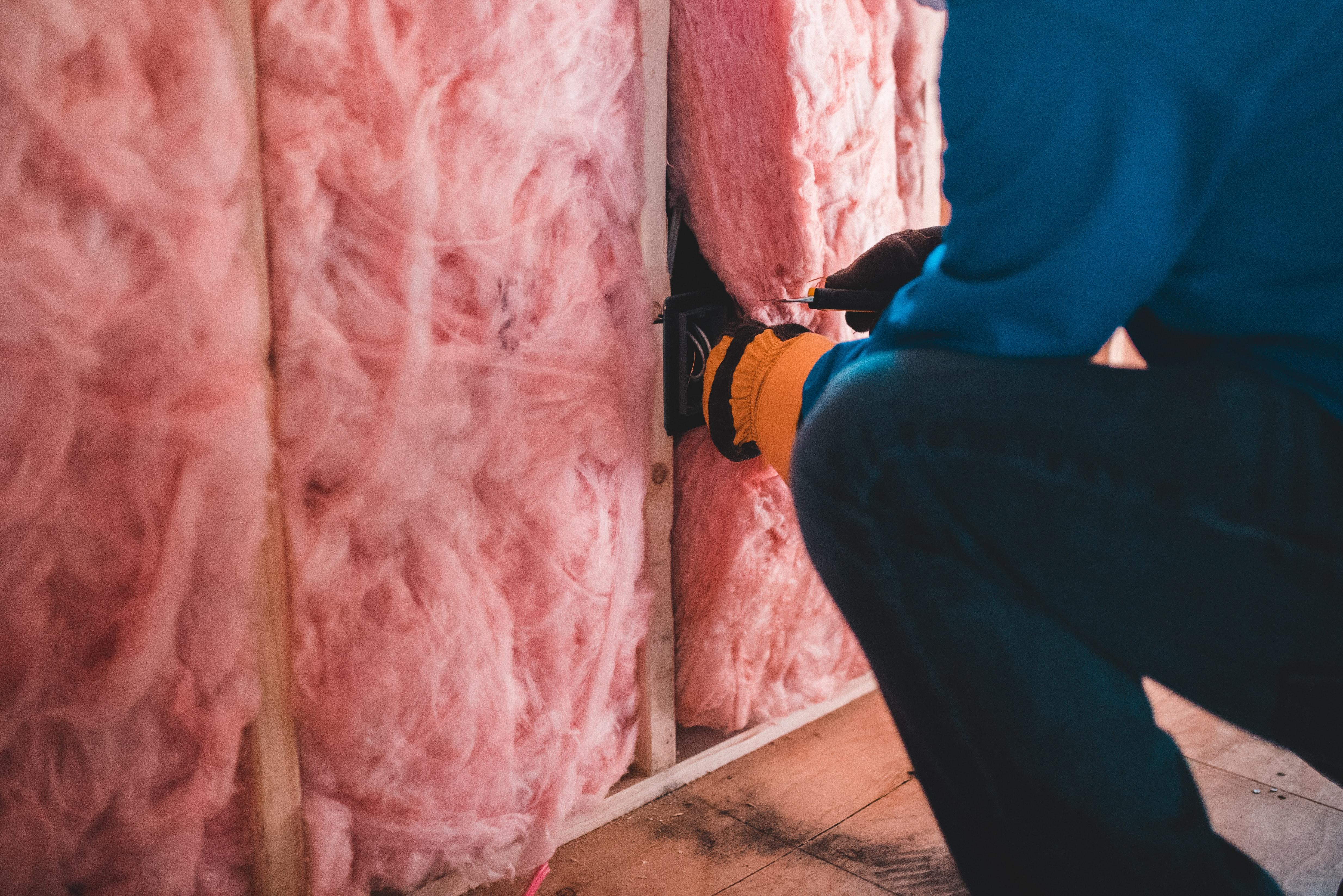 person-inserting-insulation