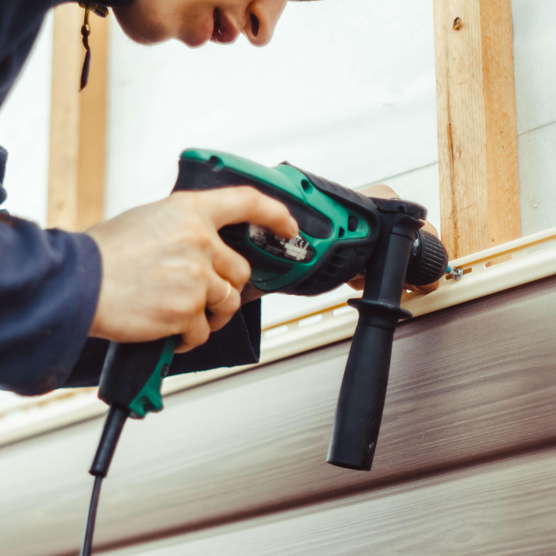 person-installing-vinyl-siding-1